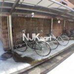 三鷹駅徒歩9分の賃貸マンション(駐輪場の写真)
